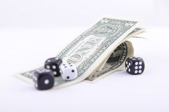 DICE AND ONE-DOLLAR BILLS Stock Photo