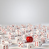Dice. One red dices among many white Royalty Free Stock Images