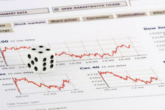Dice over stock market graphs Stock Photo