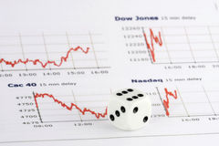 Dice over stock market graphs Stock Image