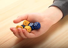 Dice on palm Stock Photos