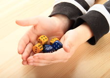 Dice on palms Royalty Free Stock Photo