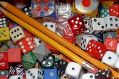 Dice and Pencils royalty free stock photo