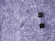 Dice. Photograph of two dice on stone floor Royalty Free Stock Photography