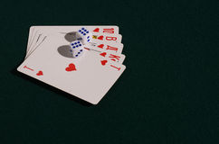 The dice and playing cards  on green broadcloth. Stock Photos