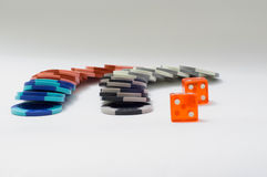 Dice. Playing dices and gambling chips on the table Stock Photos