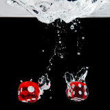 Dice playing in the water Royalty Free Stock Images