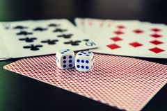 Dice with cards on the table royalty free stock image