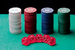 Dice and poker chips on a black background Stock Photography