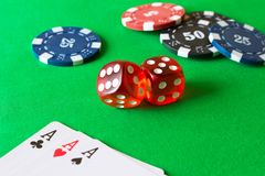 Dice, poker chips and playing cards on the green table . Game co royalty free stock photography
