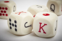 Dice poker game. Craps detail in white vignetting background Royalty Free Stock Image
