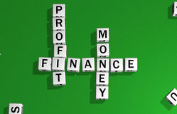 Dice profit, finance and money. Dice on a green carpet making the word money, finance and profit Stock Images
