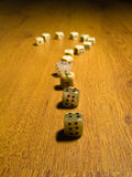 Dice question. Dice in the form of the question mark on a wood background Stock Photo
