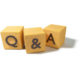 Dice with questions and answers Stock Images