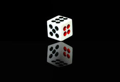 A dice with reflection Stock Image