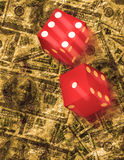 Dice roll on grunge US currency background Royalty Free Stock Photos