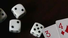 Dice roll on the surface of the table. stock footage