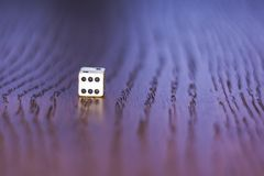 Dice 1. The dice roll on the wooden table. Role-playing game Dungeons and Dragons. Gambling in the casino Stock Photo