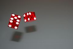 Dice rolling. A pair of red dice rolling Stock Photos