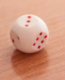 Dice rolling three. Stock Photography