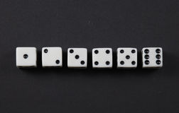 Dice in a row showing numbers one to six Stock Photography