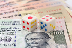 Dice on rupee notes Royalty Free Stock Images