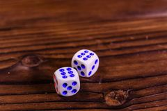 Dice on a wooden table. Gamble concept. Dice on a rustic wooden table. Gamble concept royalty free stock photos