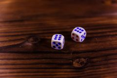 Dice on a wooden table. Gamble concept. Dice on a rustic wooden table. Gamble concept royalty free stock image