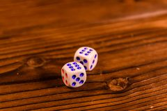 Dice on a wooden table. Gamble concept. Dice on a rustic wooden table. Gamble concept royalty free stock images