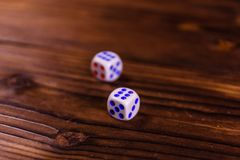 Dice on a wooden table. Gamble concept. Dice on a rustic wooden table. Gamble concept royalty free stock photo