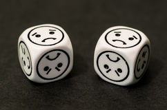 Dice with sad emoticon sides Royalty Free Stock Photography