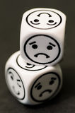 Dice with sad emoticon sides Royalty Free Stock Images