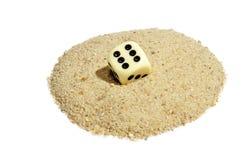 Dice on Sand Stock Photo