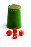 Dice Shaker and Dice. Green Leather Dice Shaker and Four Red Dice on Isolated White Background Stock Photo