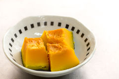Dice shaped cut steamed Japanese pumkin Stock Photo