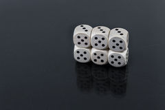 Dice six fives on a black background Stock Photo