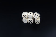 Dice six fives on a black matte background Royalty Free Stock Photography