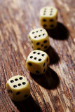 Dice with sixes in a row Stock Photography