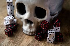 Dice Skull Gambling Concept. Grunge evil skull with gambling dice concept royalty free stock photos