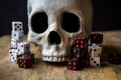 Dice Skull Gambling Concept. Grunge evil skull with gambling dice concept stock photography