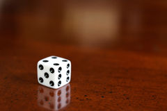 Dice. A small cube with each side having a different number and used in gambling or other game Royalty Free Stock Image