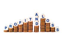 Dice Spelling Profit and Loss on Pennies royalty free stock images