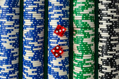 Dice on a Stack of Poker Chips Stock Photography