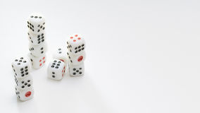 Dice. Stack of white dice on a white background Stock Image