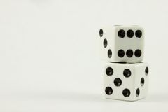 Dice Stacked. Isolated Dice on top of each other Stock Photography
