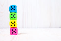Dice stacked on the wooden surface Royalty Free Stock Photography