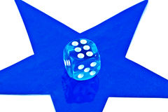 Dice on star Stock Photography