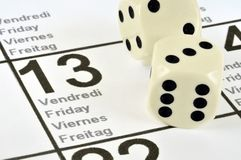 Friday the 13th. Dice to play on a calendar on Friday 13th royalty free stock photos