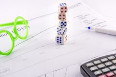 Dice tower business frequency table with pointer pen calculator glasses Royalty Free Stock Image
