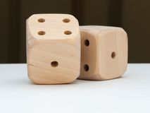 Dice. Two wooden dice on a white table stock photo